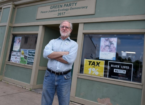 Howie Hawkins in front of store front